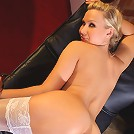 Michelle slips off her white panties to show off her perfect body in only her white holdups.