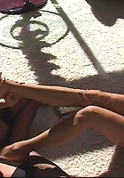 A pair of feisty nylon stocking vixens have a sexual romp in the smoke and sun