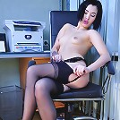 Red hot secretary slowly strips to her classy black stockings in the office