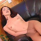 Footsy chick in control top pantyhose fingering her pussy on the armchair
