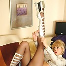 Freaky gal licking her high heels and every toe clad in barely black tights